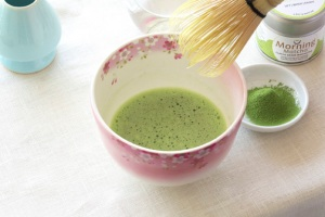 matcha tea whisked in a bowl